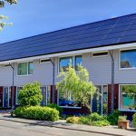 row of houses with solar roofing