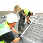 saving energy uk engineers installing solar power